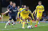 AFC Wimbledon defender Terell Thomas (6) battles for possession with Southend United midfielder Luke Hyam (4) during the EFL Sky Bet League 1 match between Southend United and AFC Wimbledon at Roots Hall, Southend, England on 16 March 2019.