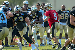 July 28, 2018 - New Orleans, LA, U.S. - METAIRIE, LA. - JULY 28:  New Orleans Saints quarterback Drew Brees (9) runs through a drill with running back Alvin Kamara (41) during New Orleans Saints training camp practice on July 28, 2018 at the Ochsner Sports Performance Center in New Orleans, LA.  (Photo by Stephen Lew/Icon Sportswire) (Credit Image: © Stephen Lew/Icon SMI via ZUMA Press)