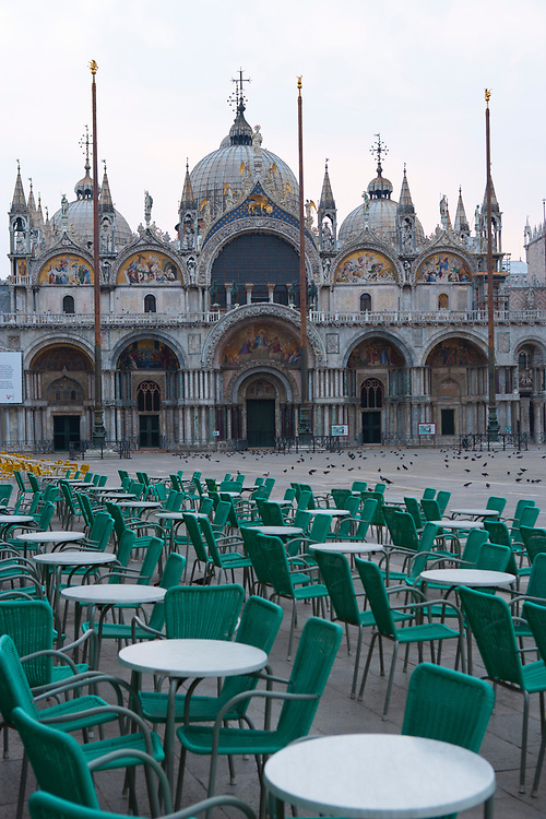St. Mark's Basilica with cafe tables at dawn, Piazza San Marco, Venice, Italy