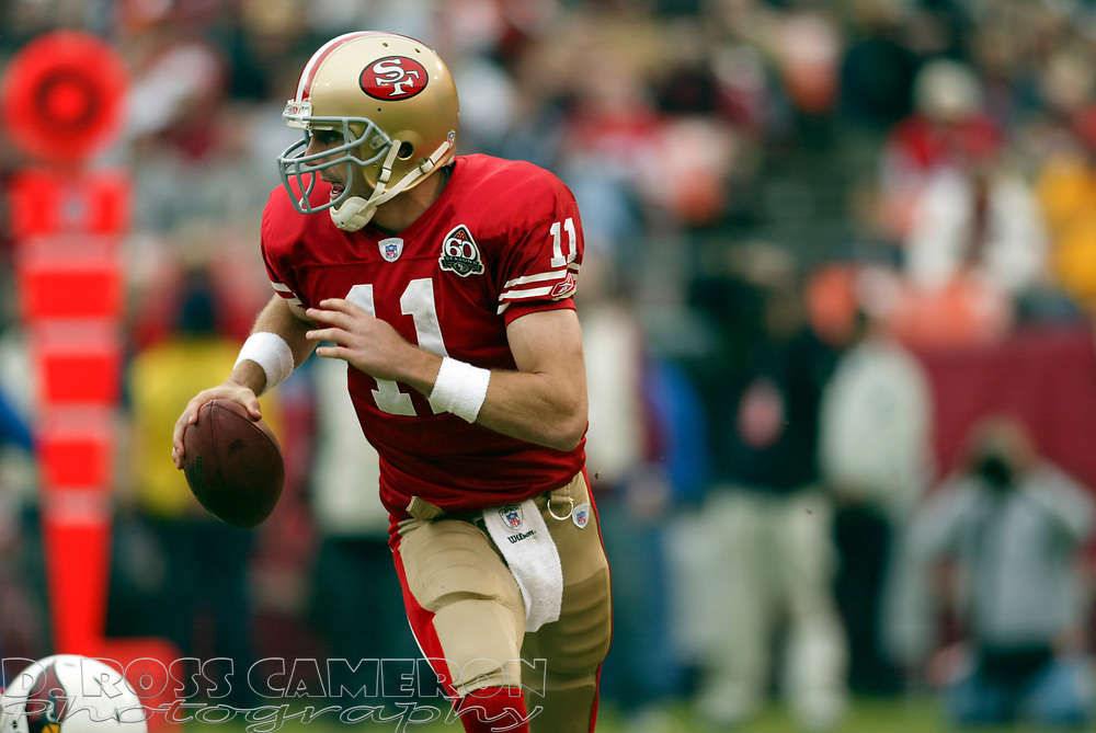 San Francisco 49ers quarterback Alex Smith (11) scrambles away from pressure during the second quarter of an NFL football game against the Arizona Cardinals, Sunday, Dec. 24, 2006 at Candlestick Park in San Francisco. The Cardinals won, 26-20. (D. Ross Cameron/The Oakland Tribune)