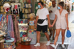 © Licensed to London News Pictures. 30/08/2020. Athens, Greece. Tourists wear face coverings as they enter a shop in central Athens. Greece could be put on the UK quarantine list after a spike in coronavirus cases. Photo credit: Ioannis Alexopoulos/LNP