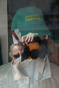 """April, 20th 2020 - Paris, Ile-de-France, France: Parisians wearing masks isolating in the hope of protecting themselves from the spread of the Coronavirus, during the first month of near total lockdown imposed in France. A week after President of France, Emmanuel Macron, said the citizens must stay at home for at least 15 days, that has been extended. He said """"We are at war, a public health war, certainly but we are at war, against an invisible and elusive enemy"""". All journeys outside the home unless justified for essential professional or health reasons are outlawed. Anyone flouting the new regulations is fined. Nigel Dickinson"""