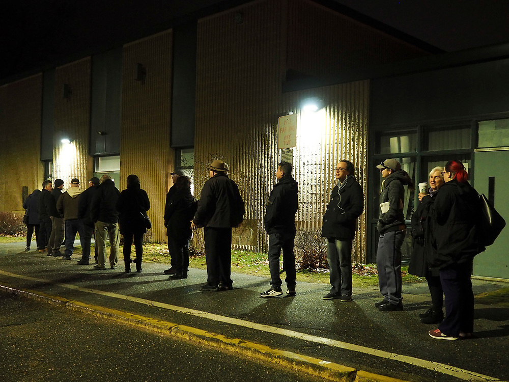 Early morning voters in Nashua NH Ward 8 stand in line prior to the polling site's 6am opening. Nashua is one of a handful on New Hampshire towns that opens polls early and closes late.