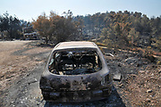On May 23 2019, a forest fire devastated the village of Mevo Modiim, Israel. Remains of a burnt car