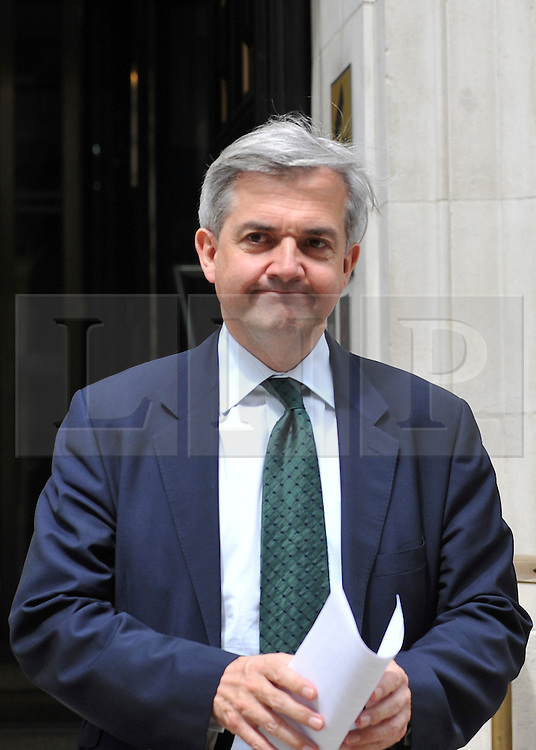 © licensed to London News Pictures. File picture dated 17/05/2011. Chris Huhn Whitehall London. 03/02/2012 Chris Huhne today learns whether he will be charged in relation to allegations that he and his ex-wife, Vicky Pryce, conspired to pervert the course of justice in relation to a speeding incident. It has been alleged that Mr Huhne asked Miss Pryce, then his wife, to take his penalty points following the incident, which took place in March 2003. If charged then it is believed Mr Huhne will have to step down from his cabinet post: Photo credit : Stephen Simpson/LNP