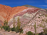 """Purmamarca And The Hill of Seven Colors<br /> <br /> Cerro de los Siete Colores or """"The Hill of Seven Colors"""" is one of the hills bordering the tiny village of Purmamarca, in Jujuy Province, in north-western Argentina. Sprung up around seventy-five million years ago, the hill was formed by a complex geological process that involved deposition of sea, lake and river movements and subsequent elevation of the land due to the movement of the tectonic plates. The hill is called such due to the various pigments acquired by the minerals that make up the sedimentary layers. It is said that you can see seven colors in the hill, but most people can pick out only four. The colors are most clearly visible in the morning. The hill is best seen from the main road about 400 meters before entering the village.<br /> ©Amazing Planet/Exclusivepix"""