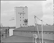 "Ackroyd 07126-3. ""Leval Mickelson. Cargill Grain elevators. September 10, 1956"" (Balfour, Guthrie & Co., Bunge Grain, Permanente Cement dock, Cargill Irving grain elevator, ECSI # 5561, 800 N. River St.)"
