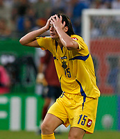 Photo: Glyn Thomas.<br />Italy v Ukraine. Quarter Finals, FIFA World Cup 2006. 30/06/2006.<br /> Ukraine's Artem Milevskiy with his head in his hands.