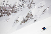 Backcountry skier Sterling Roop catches turns below the summit of Hayden Peak, San Juan Mountains, Colorado.