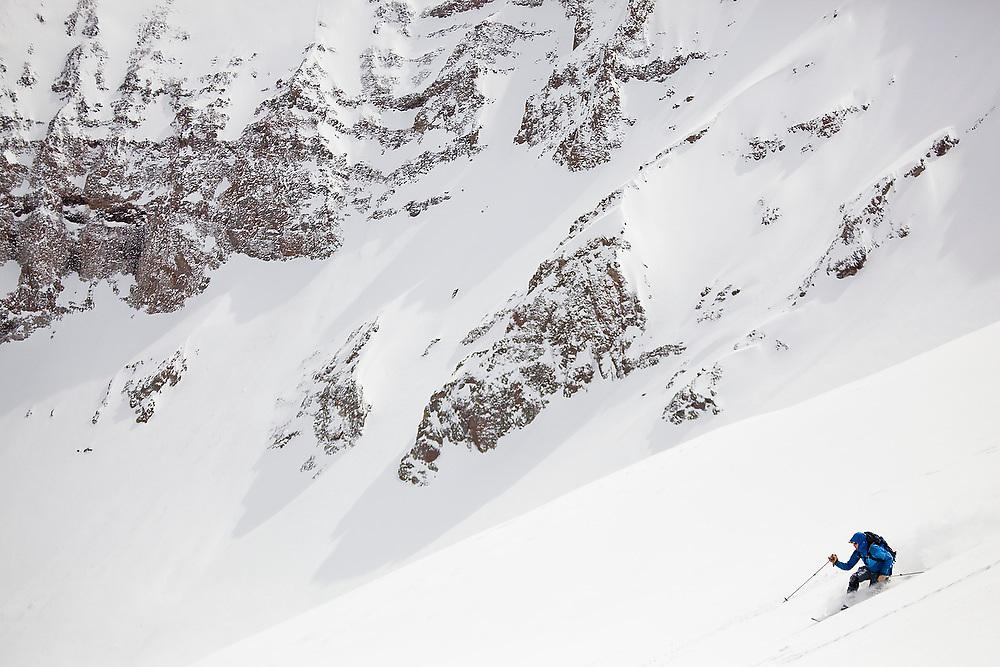 Backcountry skier Sterling Roop catches turns below the summit of Hayden Peak, San Juan Mountains, Colorado.