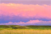 Grasslands at sunset with brewing storm (West Block)<br /> Grasslands National Park<br /> Saskatchewan<br /> Canada