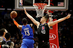 March 8, 2019 - Los Angeles, California, U.S - Oklahoma City Thunder's Paul George (13) goes to basket while defended by Los Angeles Clippers' Ivica Zubac (40) during an NBA basketball game between Los Angeles Clippers and Oklahoma City Thunder Friday, March 8, 2019, in Los Angeles. (Credit Image: © Ringo Chiu/ZUMA Wire)