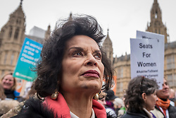 © Licensed to London News Pictures. 04/03/2018. LONDON, UK. Bianca Jagger, activist, joins the march. Hundreds of men and women take part in the annual March 4 Women campaigning for gender equality.  The walk through central London from Millbank to Trafalgar Square retraces the steps of Suffragette's ahead of International Women's Day on 8 March.  Photo credit: Stephen Chung/LNP