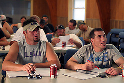 07 June 2010. Pointe aux Chenes, Louisiana.<br /> Fading away. Fisherman John Verdin (l) and Kerry Trosclair listen and learn as local Pointe aux Chenes Indians take a 40 hour Hazardous waste operation class in order to get certification to work for BP as sub contractors cleaning up oil. The isolated town of Pointe Aux Chenes clings to the little land that remains along the bayous and waterways of southern Louisiana. Oil washes up on the  marsh grasses just south of tribal homes. If the grass dies, there is nothing left to hold the land. All of this was solid ground just 100 years ago. Diversion of the mighty Mississippi River diverted sediment from the wetlands and deposited precious land building material deep out at sea.  At present, all these fishing grounds are closed. Members of the Pointe aux Chenes Indians, settlers that can trace their roots beyond 5 generations back to France face extinction of their very way of life, their very existence. French cajun is the language of the elders, but is dying out in the children of today. BP's catastrophic oil spill threatens everything, their way of life and the land on which they live. Not recognised by the federal government, the 680 member tribe struggles for funds in a small community that survives only because of fishing and oil extraction in the Gulf of Mexico.<br /> Photo; Charlie Varley/varleypix.com