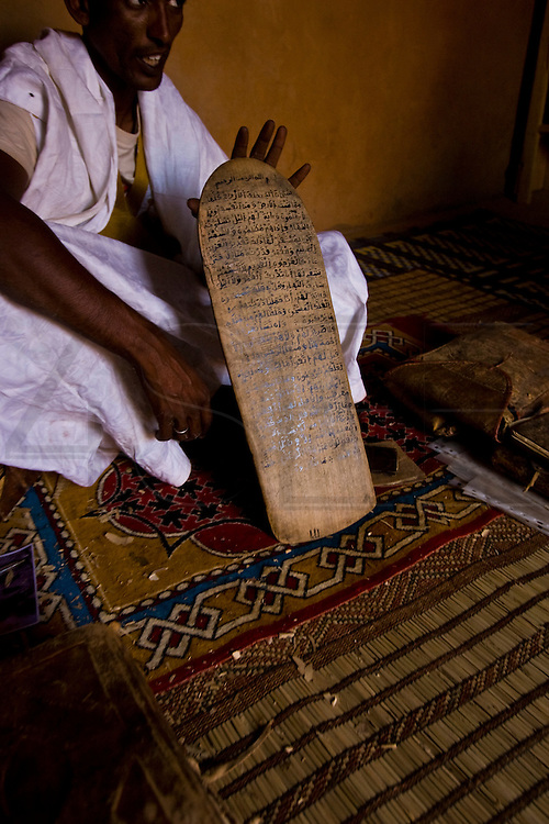 a local guide shows some of old tablets part of the 'Ahmed al Mahmoud fondation' library in Chuinguetti. Some of the manuscripts date back to the 9th century up to the 20th.