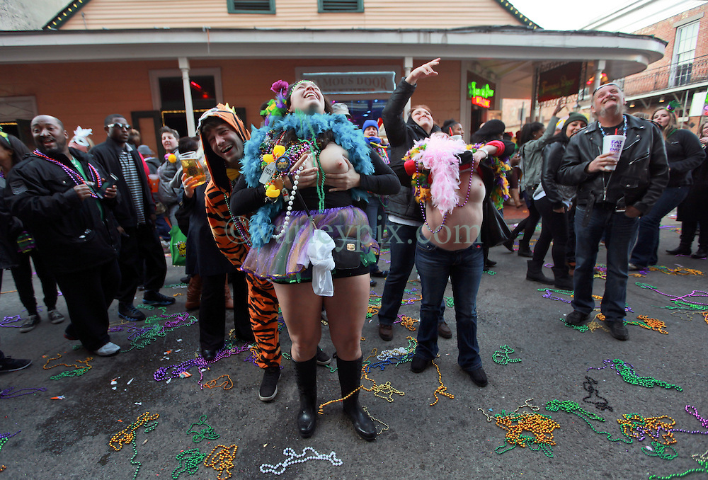 17 Feb 2015. New Orleans, Louisiana.<br /> Fat Tuesday. Mardi Gras Day. Revelers flash for beads on Bourbon Street.<br /> Photo; Charlie Varley/varleypix.com