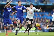 Ross Barkley of Everton is challenged by Nemanja Matic of Chelsea and Diego Costa of Chelsea. Barclays Premier league match, Chelsea v Everton at Stamford Bridge in London on Saturday 16th January 2016.<br /> pic by John Patrick Fletcher, Andrew Orchard sports photography.