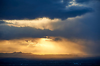 Storm at sunset, Sand Wash Basin, Colorado, USA   Photo: Peter Llewellyn