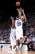 Baylor guard Aaron Bruce (14) puts up a shot under pressure from Kansas State defenders Cartier Martin (20) and Jermaine Maybank (23), during the first half at Bramlage Coliseum in Manhattan, Kansas, January 17, 2007.  K-State beat Baylor 69-60