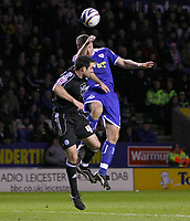 Photo: Steve Bond/Richard Lane Photography. Leicester City v Peterborough United. Coca-Cola Football League One. 20/12/2008. Steve Howard (R) and Craig Morgan (L) challange in the air