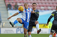 Harrison Mcgahey and James Vaughan during the EFL Sky Bet League 1 match between Wigan Athletic and Rochdale at the DW Stadium, Wigan, England on 24 February 2018. Picture by Daniel Youngs.