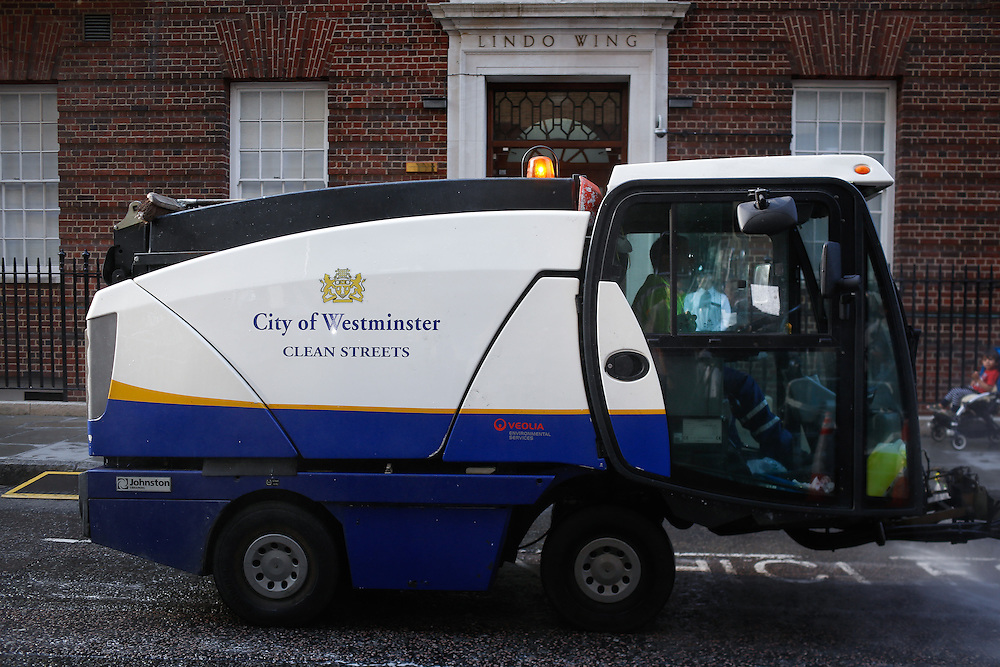 A road sweeper passes the media  after Kate Middleton arrives at The Lindo Wing at St Mary's hospital in Paddington, London on July 22, 2013.<br /> <br /> <br /> The Duchess of Cambridge arrived around 5.30  this for the arrival of a new member of the royal family. <br /> <br /> Photo By Ki Price