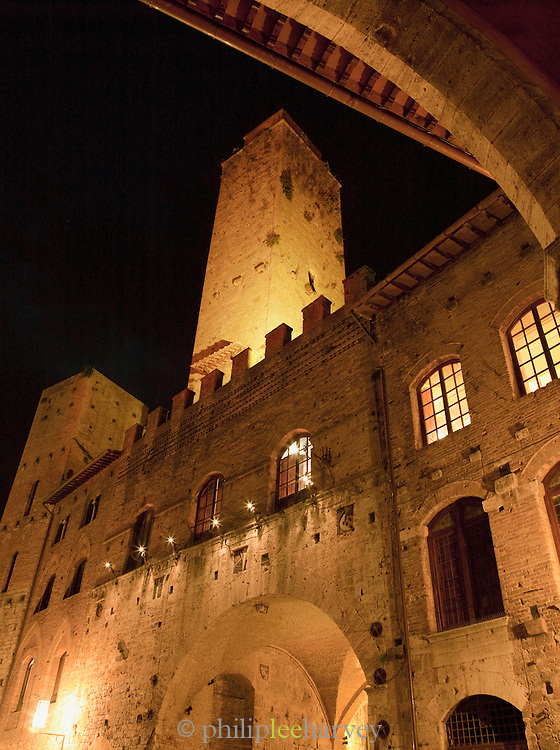Stone towers at Piazza Duomo, the main square in the medieval town San Gimignano, a UNESCO Heritage site in Tuscany, Italy