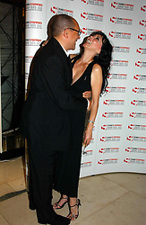 """BRUCE OLDFIELD and MARIE HELVIN at a party to celebrate the publication of Bruce Oldfield's autobiography """"Rootless"""" held in aid of Crimestoppers at Claridge's, Brook Street, London W1 on 22nd September 2004.<br /><br />NON EXCLUSIVE - WORLD RIGHTS"""