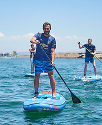 """Manchester United star Juan Mata proved he's a turf and surf kind of guy as he demonstrated his paddle boarding prowess in Los Angeles. The 30-year-old midfielder and fellow players Ander Herrera and Scott McTominay took time off the pitch during the team's USA summer tour to attend an event in collaboration with Parley For The Oceans and Adidas to raise awareness about the threat of ocean plastic to the environment. The event — which took place in a boat docked in the harbor in Los Angele's beachside community Marina Del Rey on July 27 — featured talks by the Founder of Parley for the Oceans, Cyrill Gutsch, Parley and Adidas staff members and Big Wave Surfer & Parley Ambassador Greg Long. Mata, Herrera and McTominay were joined in the audience by members of the adidas Tango Squad – the innovative global football community. The event also saw the United stars enjoy what the ocean has to offer as they took to the water to try their hands at paddle boarding, guided by Big Wave Surfer Greg Long. Mata said: """"When Adidas first introduced the Manchester United jersey Parley Ocean Plastic® I was unaware of the scale of the issue. Fans worldwide should know that this jersey is one step in the right direction, but we still have loads to do."""" Ander Herrera added: """"By taking time to understand the problem, we hope that we can use our influence to help educate the world to the scale of the issue and although we can all do more and we must, this initiative is a step in the right direction."""" And Scott McTominay said: """"It's great to be part of the Parley relationship and for our kit to use Parley Ocean Plastic®, however, I also believe that we all need to do more. I've been shocked into doing more personally and everyone should also look at steps they can take to help this situation."""" Cyrill Gutsch, Founder of Parley for the Oceans said: """"Winning Manchester United as Parley supporters is like adding eighteen thousands times the size of the British Roy"""