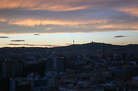 Evening rooftop view of Barcelona City<br />