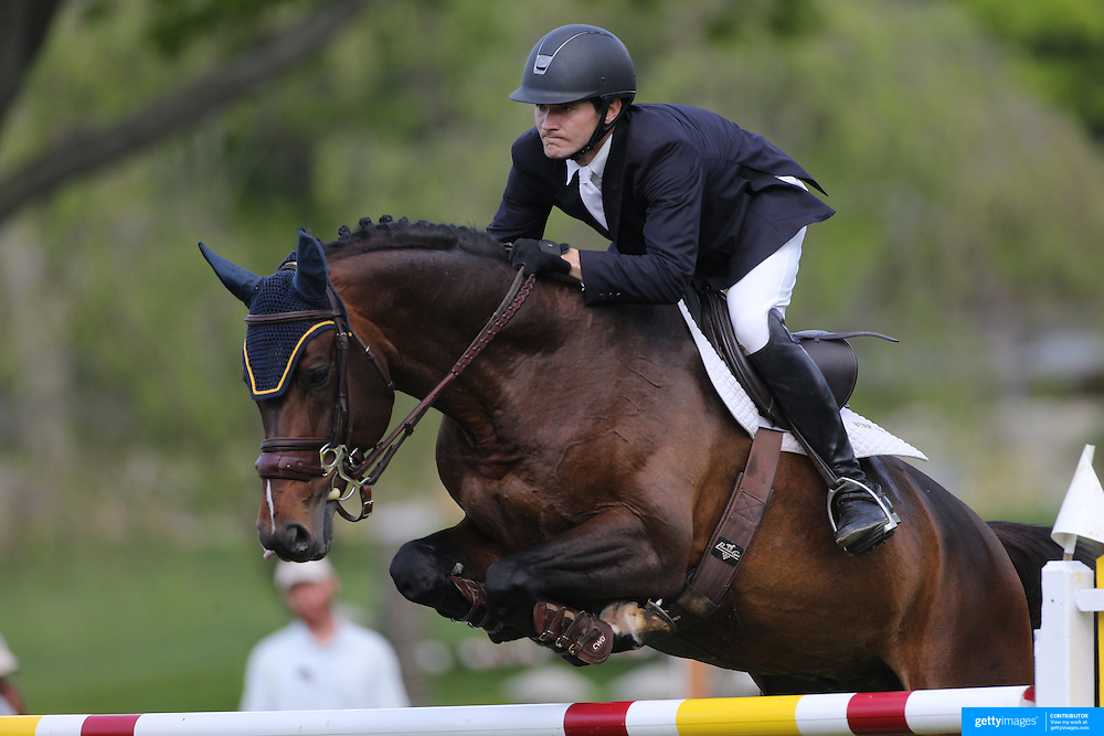 Richard Neal riding Quadam in action during the $100,000 Empire State Grand Prix presented by the Kincade Group during the Old Salem Farm Spring Horse Show, North Salem, New York,  USA. 17th May 2015. Photo Tim Clayton