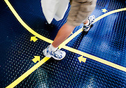 "A freshmen navigates the yellow line the indicates the pathway to take as incoming midshipmen are processed on their first day at the U.S. Naval Academy in Annapolis, MD. Approximately 1,230 young men and women arrived at the U.S. Naval Academy's Alumni Hall, Thursday, July 1, for Induction Day to begin their new lives as ""plebes"" or midshipmen fourth class (freshmen). ""I-Day"" culminates when the members of the Class of 2014 take the oath of office at a ceremony at 6 p.m. in Tecumseh Court, the historic courtyard of the Bancroft Hall dormitory. Over 17,400 young men and women applied to be members of the Naval Academy Class of 2014 - a record for USNA."
