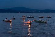 Indigenous Purépecha butterfly fisherman on Lake Patzcuaro at twilight near Janitzio Island, Michoacan, Mexico.
