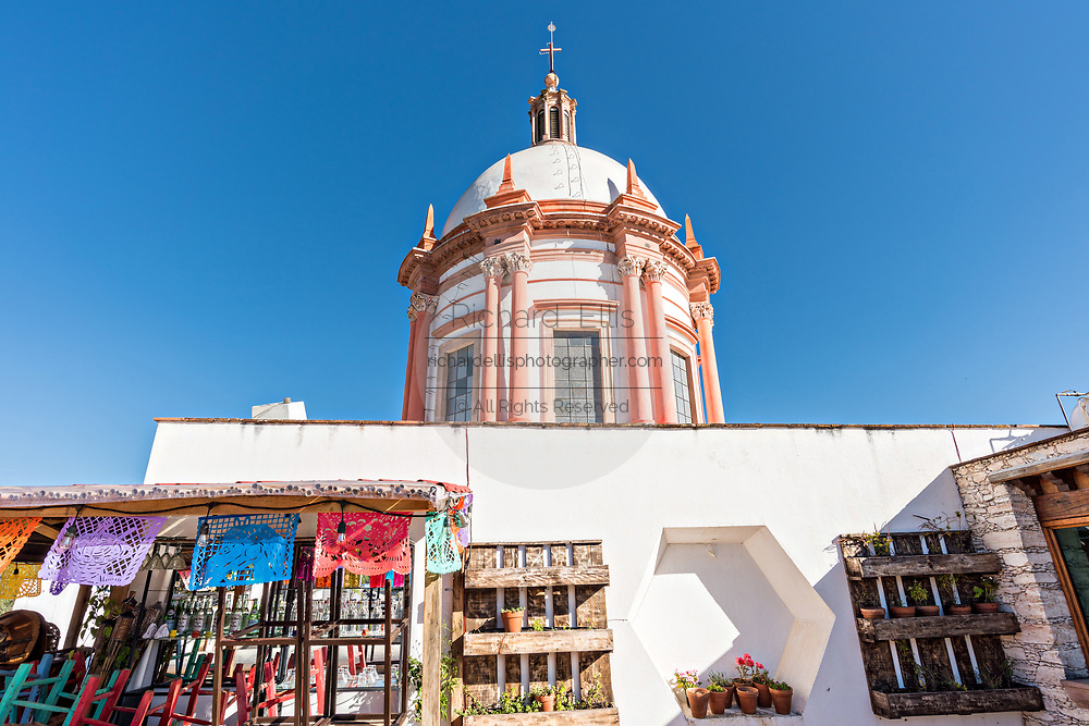The dome of the Parroquia de San Pedro Apóstol church or Saint Paul the Apostle provincial church in Mineral de Pozos, Guanajuato, Mexico. The town, once a major silver mining center was abandoned and left to ruin but has slowly comeback to life as a bohemian arts community.