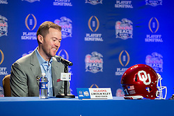 Oklahoma Sooners head coach Lincoln Riley and LSU Tigers head coach Ed Orgeron pose for a photo following their joint head coaches news conference on Friday, Dec. 27, in Atlanta. #4 Oklahoma will face #1 LSU in the 2019 College Football Playoff Semifinal at the Chick-fil-A Peach Bowl on Saturday, Dec. 28, 2019. (Jason Parkhurst via Abell Images for the Chick-fil-A Peach Bowl)
