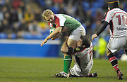 Reading, GREAT BRITAIN,   Shane GERAGHTY, feels the weight of Kieron DAWSON's tackle, during the third round Heineken Cup game, London Irish vs Ulster Rugby, at the Madejski Stadium, Reading ENGLAND, Sat 09.12.2006. [Photo Peter Spurrier/Intersport Images]