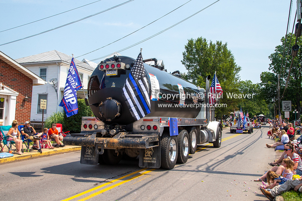A truck from J Force Trucking is seen with Trump flag and a blue lives matter flag in the Independence Day Parade in Millville, Pennsylvania on July 5, 2021. (Photo by Paul Weaver)