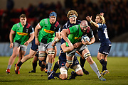 Harlequins lock Matt Symons makes a break past Sale Sharks lock Bryn Evans during a Gallagher Premiership match won by Sale Sharks 27-17 at the AJ Bell Stadium, Eccles, Greater Manchester, United Kingdom, Friday, April 5, 2019. (Steve Flynn/Image of Sport)