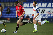 Oldham Athlteic's Danny Philliskirk breaks away from Tranmere Rovers' Jason Koumas. Skybet football league 1match, Tranmere Rovers v Oldham Athletic at Prenton Park in Birkenhead, England on Saturday 1st March 2014.<br /> pic by Chris Stading, Andrew Orchard sports photography.