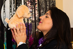 Assistant Manager Bruna Salvadori admires a cute soft toy left behind by a guest.. London, July 24 2019.