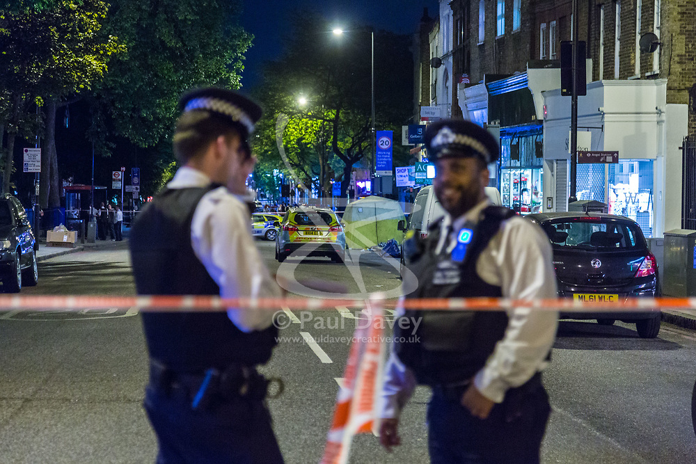 Police officers man a cordon following a fatal stabbing of a man in broad daylight at around 6.30pm on Upper Street in Islington, North London. London, May 21 2018.