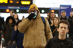 © Licensed to London News Pictures. 11/03/2020. London, UK. Passengers arriving at London's Waterloo Station wear face masks. New cases of the COVID-19 strain of Coronavirus are being reported daily as the government outlines it's plans for controlling the outbreak. Photo credit: Peter Macdiarmid/LNP