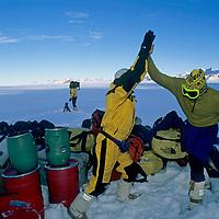ANTARCTICA, Queen Maud Land. Jon Krakauer & Alex Lowe (MR) celebrate expedition's arrival at Rakekniven base camp. in Filchner Mts.