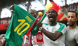 Senegal fan celebrates after getting Sadio Mane's shirt after the final whistle