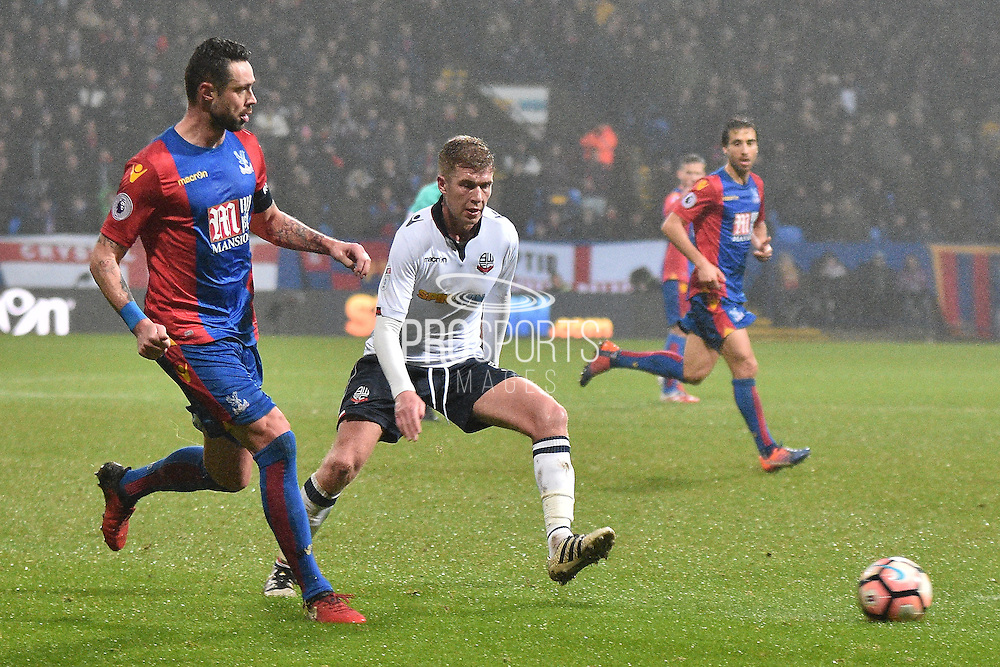 Crystal Palace Defender, Damien Delaney (27) and Bolton Wanderers Midfielder, Josh Vela (6)  during the The FA Cup 3rd round match between Bolton Wanderers and Crystal Palace at the Macron Stadium, Bolton, England on 7 January 2017. Photo by Mark Pollitt.