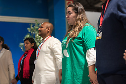 13 December 2019, Madrid, Spain: Faith-based organizations gather for a vigil, as COP25 is about to draw to a close, praying that negotiations will bear fruit, bringing about urgent and just action to find a way out of the climate crisis. Here, Lutheran World Federation delegate Fernanda Zuñiga from the Lutheran Church in Chile (right).