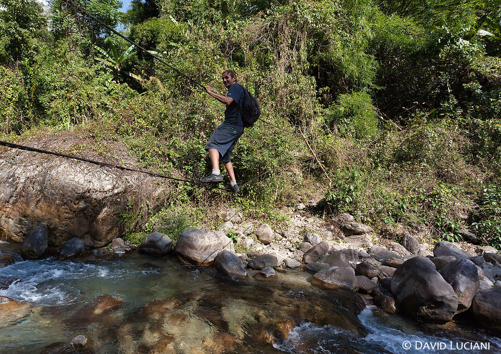 """Our guide Thierry, crossing a suspension """"bridge"""" during our trek from Sisen to Pongging."""