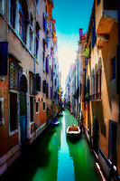 """""""Canal near the Accademia Bridge in Venice""""...<br /> <br /> The last day of our Pilgrimage was spent in one of the most iconic locations on earth, Venice! Busing to the docks at the Venetian Lagoon from Padua to catch our private boat to the Basilica di San Marco, an exemplary spiritual treasure for a special Mass in the sacristy. Touring the crowded Doge's Palace proceeded, then set free to breathe in as much of the Venetian Island as possible until our final farewell dinner and return flight home in the morning. As standard fare, my fellow Pilgrim Patrick and I took off out of the starting gate with the notion to capture the entirety of Venice in a half of a day on foot. We covered exactly 8.3 miles by foot, but with so much adrenaline, we could have doubled it into the nighttime. Our itinerary included Basilica's, canals, bridges, gondolas, and anything resembling Venetian culture, oh, and a stop for lunch. Basilica dei Frari was foremost and Chiesa di San Geremia to visit St. Lucy. The maze that Venice presents, GPS navigation only works occasionally on this crowded water complexity. The shutters on our cameras seemed permanently depressed as we desperately tried to capture everything we possibly could in such a short window of time, as we had to be at the waterside restaurant by 7:00 pm. It was a Bellissimo Spring day, and of course, we stopped for an Aperitivo which I also fell in love with on this replete journey. We artfully meandered the narrow walkways and canals with a keen rhythm and capture of all that was superior. Not a thought of distance occurred in our surreptitious mission of Venice. We finally made it by dusk to our waterway restaurant Ristorante Pizzería Da Alvise, which was authentic and excellent. The finest shrimp I have experienced, grateful speeches emanated the tiny venue. Melancholy gratification filled the ambiance as we said our final farewells to Italy and the wonderful new friendships and experiences we shared on this Pilgrimage of a """