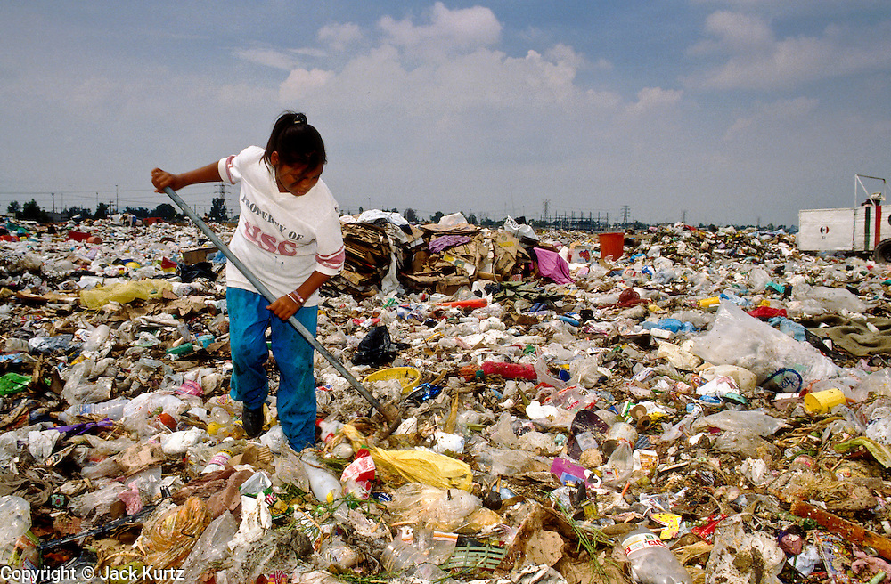 CIUDAD NEZAHUALCOYOTL, DF, MEXICO: A woman sorts through garbage in the Ciudad Nezahualcoyotl dump on the edge of Mexico City, Sept. 23, 1993. Hundreds of people live in the dump and make a living by scavenging through the refuse brought to the dump by Mexico City's garbage trucks.  PHOTO ©  JACK KURTZ   POVERTY  HOMELESS  ECONOMY   SOCIAL ISSUES   LABOUR  WOMEN