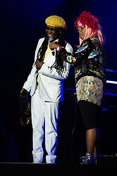 © Licensed to London News Pictures. 07/09/2014. Isle of Wight, UK. Disco legend Nile Rodgers on stage Bestival 2014 when a giant disco ball created for the festival is judged by Guinness to the worlds largest disco ball.  The festival theme is Desert Island Disco.  Day 4 Sunday the festivals final day.  This weekend's headliners include Chic featuring Nile Rodgers, Foals and Outcast.   Bestival is a four-day music festival held at the Robin Hill country park on the Isle of Wight, England. It has been held annually in late summer since 2004.    Photo credit : Richard Isaac/LNP